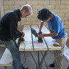 Kevin W. and John. M. hard at work sanding.