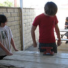 Steven M. and Pace B. begin work on one of the tables. This one had a board so termite-eaten that it needed to be replaced.