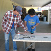 Mr. Heins advises John M. on installing the replacement board.