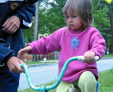 Anna riding a bike.