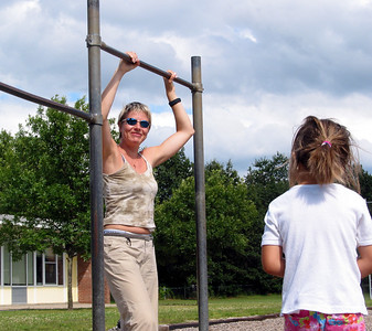 Olga Korbut in preparation for move attempted never before, playground at Hiawatha, summer 2004.