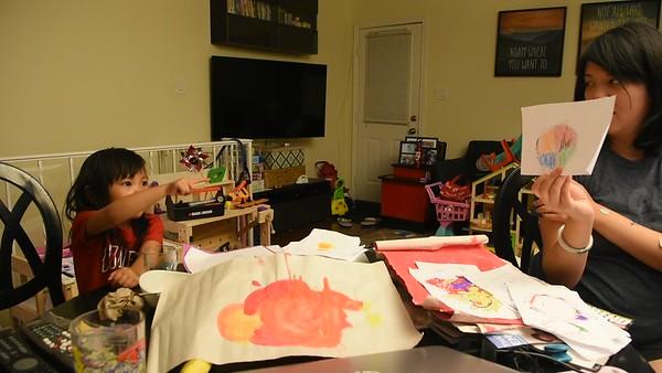 Skye explains school work to Joy and Ma