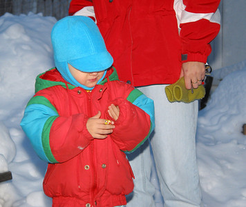 Anna and Mrs. Reichenberg at the backyard skating rink, January 2003.