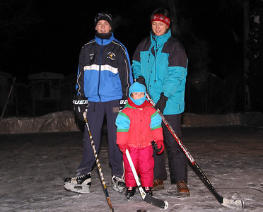 Mike, Anna and Mrs. Reichenberg at the backyard skating rink, January 2003.