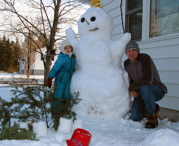 Building a snowman.