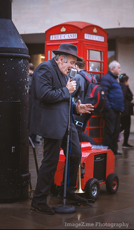 A singer on the street in a rainy afternoon. Bath, UK