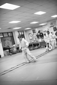 The agility ladder helps with footwork, and that improves takedowns and takedown defense.