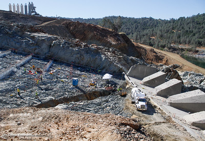 At the base of the Spillway workers power wash the bedrock Friday July 7, 2017 in Oroville, California.  (Emily Bertolino -- Enterprise-Record)