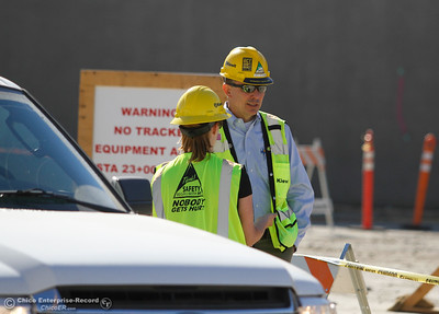 Jeff Petersen, project manager and Kiewit's Northern California vice president talks with Natural Resources representative Erin Mellon on the Spillway Friday July 7, 2017 in Oroville, California.  (Emily Bertolino -- Enterprise-Record)