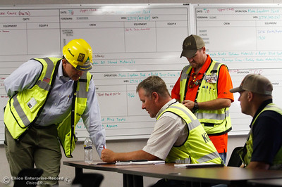 "Jeff Petersen, project manager and Kiewit's Northern California vice president talks with Ethan Brand, concrete manager in what they call the ""war room,"" Friday July 7, 2017 in Oroville, California.  (Emily Bertolino -- Enterprise-Record)"