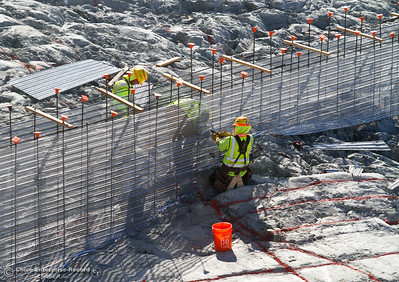 Craftspeople prepare the center of the Spillway for the leveling concrete Friday July 7, 2017 in Oroville, California.  (Emily Bertolino -- Enterprise-Record)