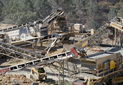 Rocks work their way through the on-site batch plant Friday July 7, 2017 in Oroville, California.  (Emily Bertolino -- Enterprise-Record)