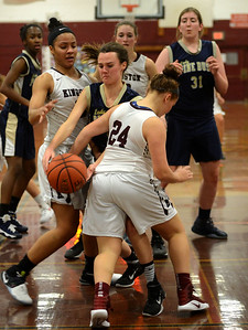 Tania Barricklo-Daily Freeman                      Pine Bush's Molly Mulhare gets squuezed between ingston's Chloe Chaffin and Madison Burke