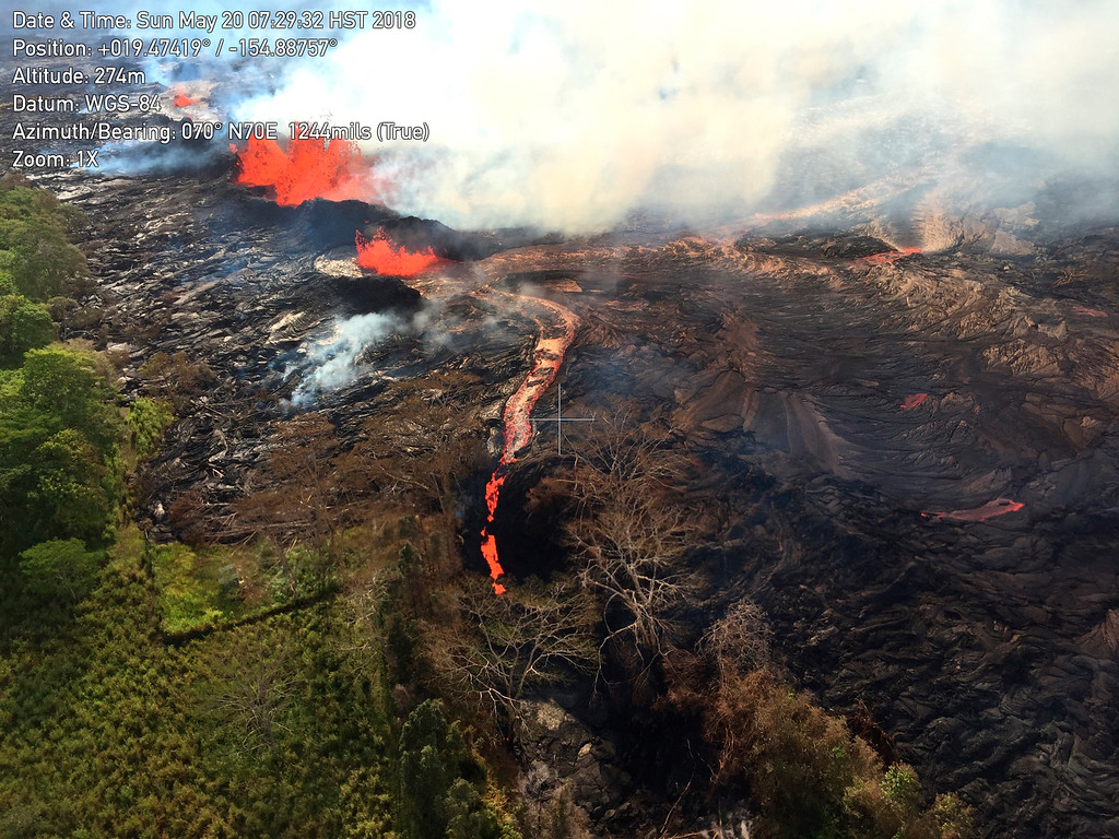 . In this Sunday, May 20, 2018, aerial image provided by the U.S. Geological Survey, lava from the eastern channel of the Fissure 20 complex flows into a crack in the ground that opened on the morning of Sunday, May 20 in Pahoa, Hawaii. Kilauea volcano began erupting more than two weeks ago and has burned dozens of homes, forced people to flee and shot up plumes of steam from its summit that led officials to distribute face masks to protect against ash particles. (U.S. Geological Survey via AP)