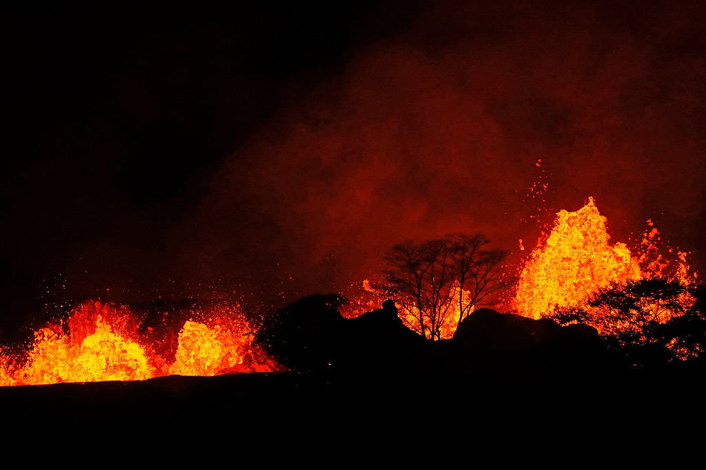 . In this Saturday, May 19, 2018 photo, lava erupts inside the Leilani Estates in Pahoa, Hawaii. As lava flows have grown more vigorous in recent days, there\'s concern more homes may burn and more evacuations may be ordered. (Jamm Aquino/Honolulu Star-Advertiser via AP)