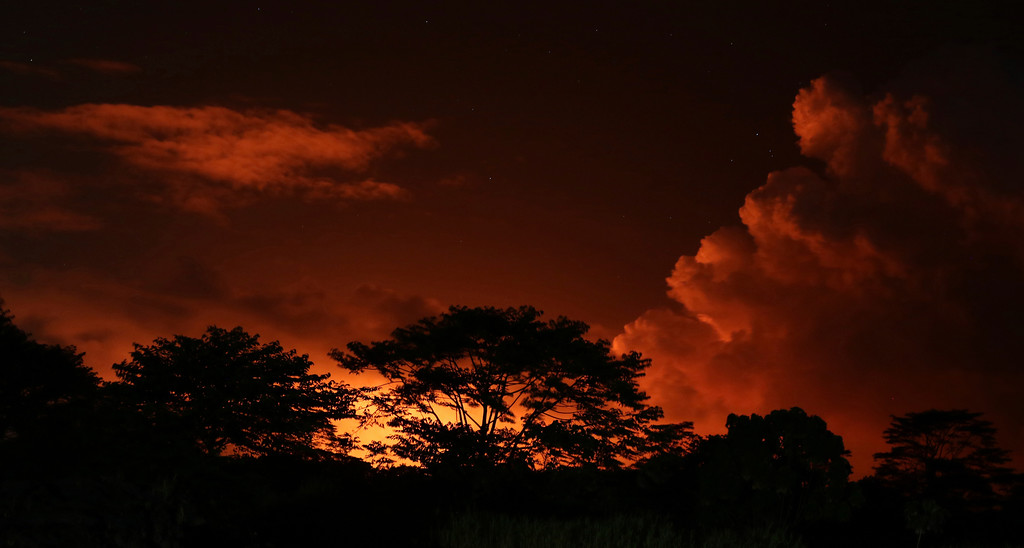 . Lava from Kilauea volcano lights up the night sky near Pahoa, Hawaii, Saturday, May 19, 2018. (AP Photo/Caleb Jones)