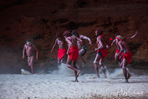 """HALLS CREEK, WESTERN AUSTRALIA, AUSTRALIA - JULY 13, 2013:  Men of the """"Karjanarna Jaru"""" perform a traditional dance depicting an """"initiation ceremony"""" for young adult indigenous man in the natural amphitheatre in Cathedral Gorge in the Purnululu National Park"""