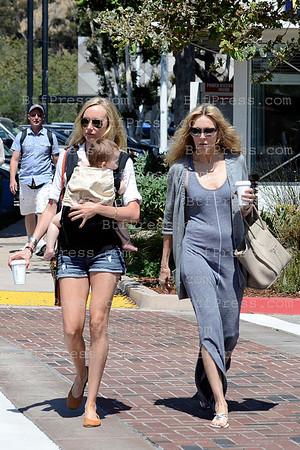 Kimberly Stewart take a walk with her baby and her mother Alana Stewart in Malibu, California.