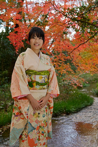 Young Japanese in Kimono with Autumn Foliage  Standing at Riverside, Laughing at Camera