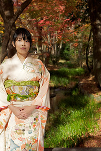 Japanese Girl in Kimono walking in Autumn Forest