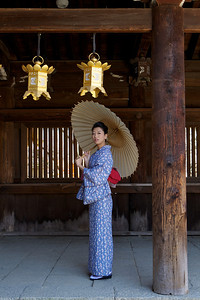 Young Japanese Lady in Kimono  Posing in a Wooden Temple Corridor