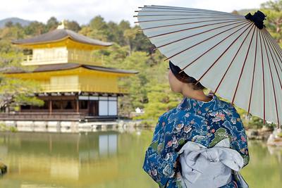 Japanese World Cultural Heritage Kinkaku-ji Temple in Kyoto  Kimono Girl posing in Front in full Sunshine