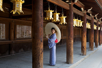 Kimono Girl posing with Parasol in Wooden Temple Corridor