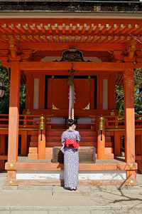 Beautiful Woman with Kimono   Standing in front of Shrine, Back View