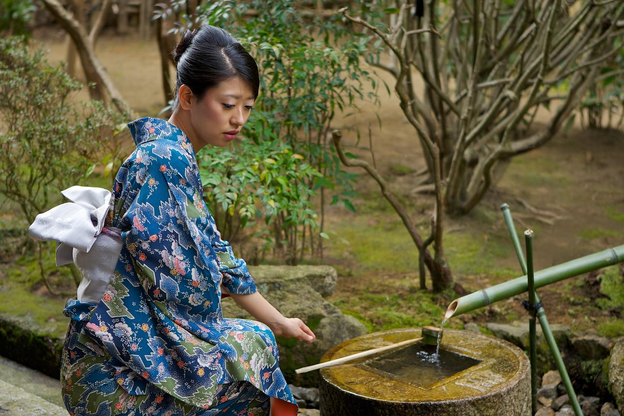 Beautiful Woman dressed in Kimono  At Japanese World Cultural Heritage Ryoanji Temple