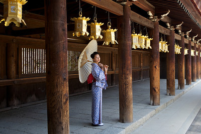 Dressed up in Kimono with Umbrella  Young Lady under Lanterns in Wooden Temple Corridor