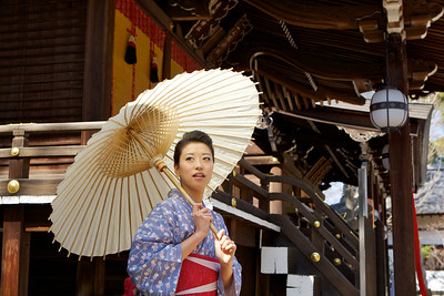 Young Woman with Parasol in Front of Temple Building  At Kitano Tenmangu Shrine, Kyoto, in Kimono