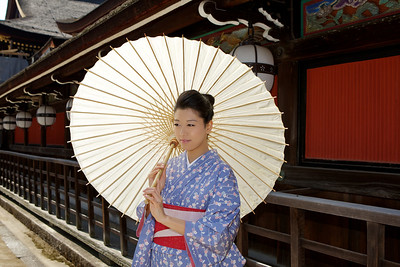 Kimono Girl with Parasol  In Front of a Shrine Building