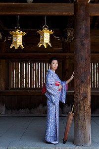 Young Japanese at Temple  Posing with Kimono in a Wooden Gallery