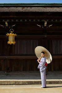 Beautiful Woman with Kimono and Parasol