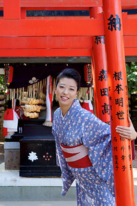 Enjoying Sightseeing  Young Japanese in Kimono laughing at Camera