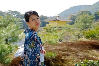 Beautiful Woman with Kimono  Japanese World Cultural Heritage Kinkaku-ji Temple in Kyoto  Posing in Front in full Sunshine