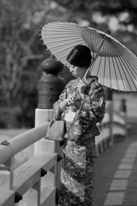 Beautiful Woman with Kimono  Standing on a Bridge at the Imperial Palace Garden, Kyoto