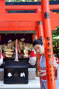 Young Japanese in Front of Shinto Shrine  Posing in Kimono and Obi
