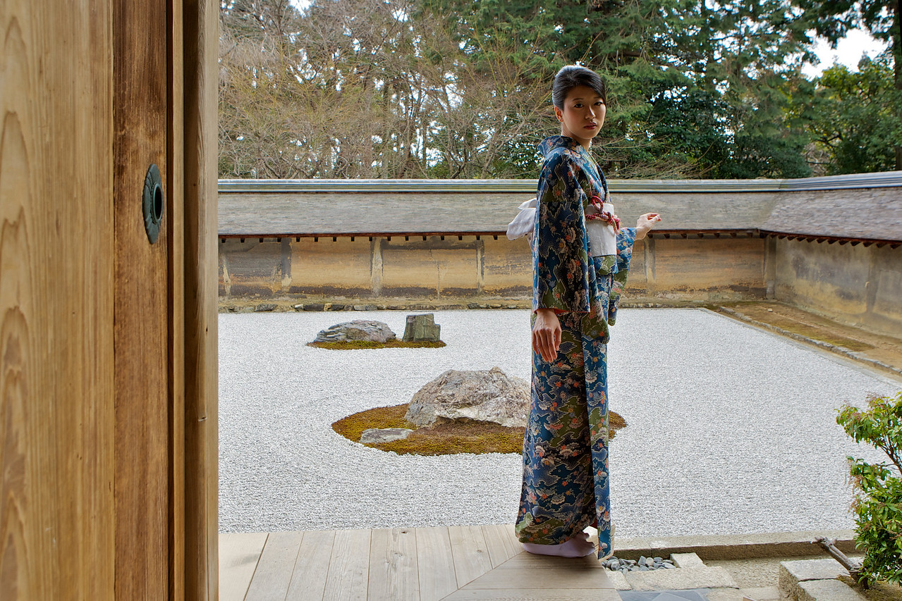 Beautiful Woman dressed in Kimono  At Japanese World Cultural Heritage Ryoanji Temple