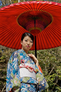 Beautiful Woman with Kimono under Red Parasol