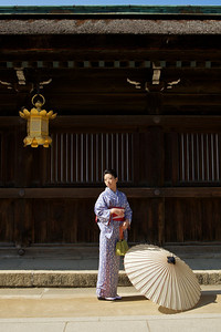 Beautiful Woman with Kimono  Moving in Front of Temple