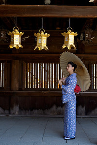 Young Japanese Lady in Kimono  Posing with Parasol in Wooden Corridor