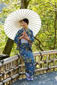 Japanese World Cultural Heritage Kinkaku-ji Temple in Kyoto  Kimono Girl posing in Sunshine