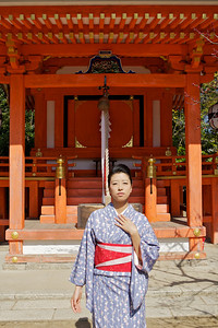 Beautiful Woman with Kimono in front of Shrine