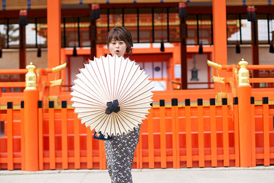 Cute Girl in Kimono at Fushimi-inari Shrine  Posing with white Parasol in Front of Shrine Building