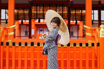 Cute Girl in Kimono at Fushimi-inari Shrine  Posing with Parasol