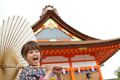 Cute Girl in Kimono at Fushimi-inari Shrine  Funny Pose with Parasol