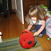 "4/4/2010 - putting her ""insect"" (plastic) eggs into her lady bug basket..."