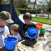 4/10/2011 - Robert and Logan taking this whole sand pouring thing seriously.