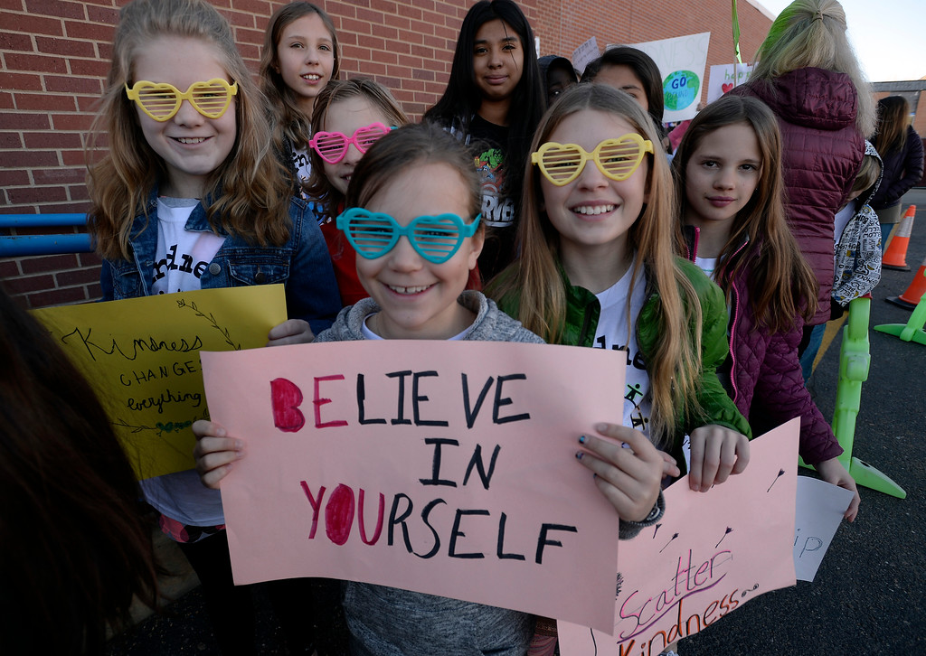 . Elise Wisner, center, is joined by some of her classmates, Francesca Alexander, Brooke Jones and Emelie Sprague, getting ready to march. Creekside Elementary  5th graders, Madi Arnold and Lila Nuttle, and 4th grader Grant Sims, led a Kindness March outside the school to celebrate diversity and kindness. For more photos, and a video, go to www.dailycamera.com. Cliff Grassmick  Staff Photographer  February 14, 2017
